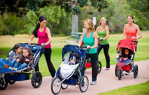 1338354595_getty_rm_photo_of_women_pushing_strollers_on_walk
