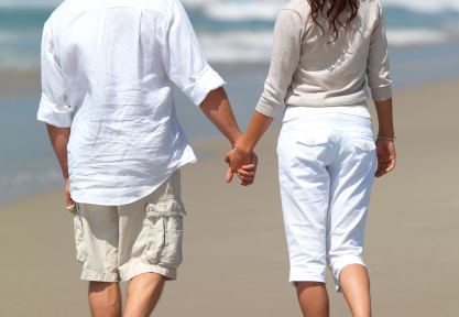 Young couple in love walking on beach